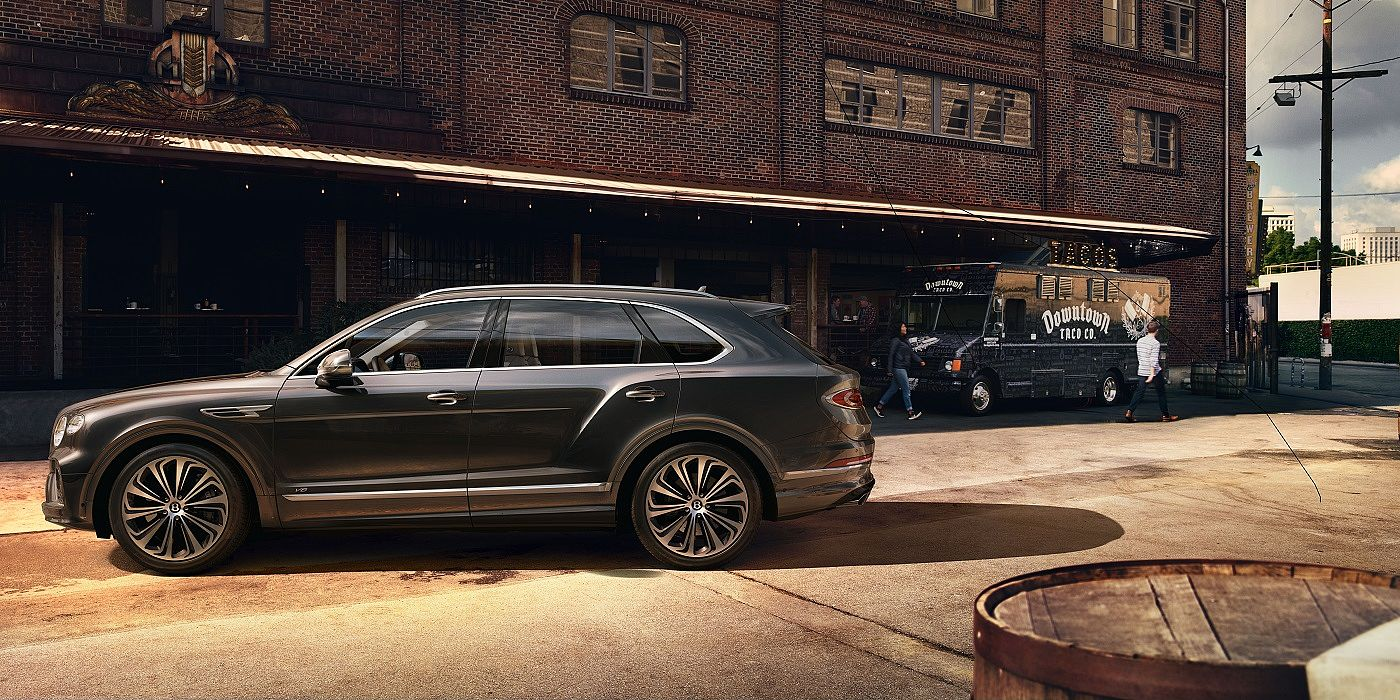 new-bentley-bentayga-v8-profile-outside-warehouse-in-hallmark-paint-2020